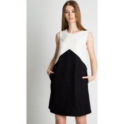 Sukienka bez rękawów z kieszeniami z boku BIALCON. Białe sukienki damskie BIALCON, z tkaniny, biznesowe, z klasycznym kołnierzykiem, bez rękawów. Za 279.00 zł.
