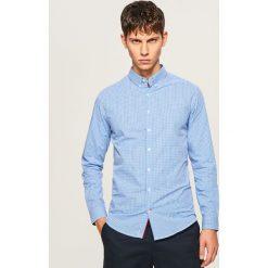 Koszula slim fit w drobną kratkę - Niebieski. Niebieskie koszule męskie Reserved, w kratkę. W wyprzedaży za 49.99 zł.