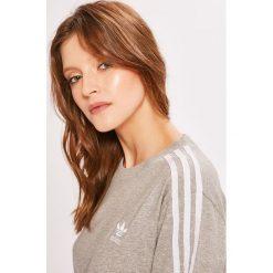 Adidas Originals - Top. Topy damskie adidas Originals, z bawełny, z okrągłym kołnierzem, z krótkim rękawem, krótkie. Za 129.90 zł.