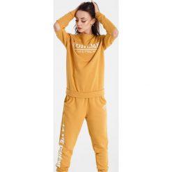 Naoko - Bluza Boheme Soleil x Edyta Górniak. Pomarańczowe bluzy damskie NAOKO, z nadrukiem, z bawełny. W wyprzedaży za 129.90 zł.