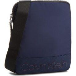 Saszetka CALVIN KLEIN - Shadow Flat Crossove K50K503907 443. Niebieskie saszetki męskie Calvin Klein, z materiału, młodzieżowe. Za 299.00 zł.