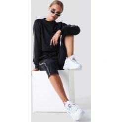 NA-KD Spodnie sportowe - Black. Spodnie sportowe damskie marki Nike. W wyprzedaży za 56.78 zł.