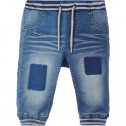 """Dżinsy """"Bob"""" w kolorze niebieskim. Niebieskie jeansy dla chłopców Name it Baby. W wyprzedaży za 49.95 zł."""
