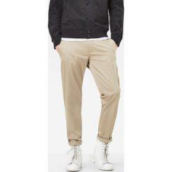 G-Star Raw - Spodnie. Szare eleganckie spodnie męskie G-Star Raw, z bawełny. W wyprzedaży za 269.90 zł.