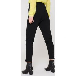Rut&Circle Spodnie Delia - Black. Czarne spodnie materiałowe damskie Rut&Circle, z haftami, z poliesteru. Za 121.95 zł.