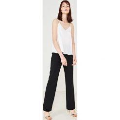 d888a07dd5 Simple - Spodnie. Spodnie materiałowe damskie marki Simple. W wyprzedaży za  199.90 zł.