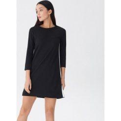 Sukienka z lampasami - Czarny. Czarne sukienki damskie House. Za 79.99 zł.