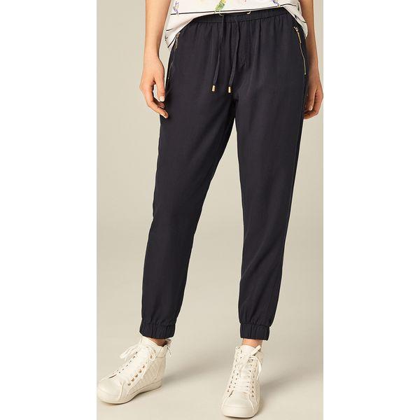 a68e81dc9975 Luźne spodnie ze ściągaczami - Niebieski - Spodnie materiałowe ...