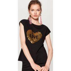 Bawełniana koszulka z aplikacją - Czarny. Bluzki damskie marki DOMYOS. W wyprzedaży za 39.99 zł.