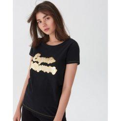 Koszulka Harry Potter - Czarny. Czarne t-shirty damskie House. Za 29.99 zł.