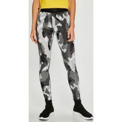 Nike Sportswear - Legginsy. Szare legginsy damskie Nike Sportswear, z bawełny. W wyprzedaży za 119.90 zł.
