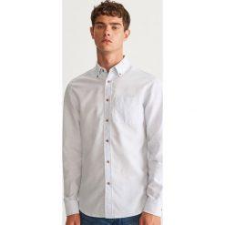 Koszula slim fit z bawełny organicznej - Biały. Białe koszule męskie Reserved, z bawełny. Za 69.99 zł.