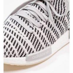 Adidas Originals NMD_R1 STLT PK Tenisówki i Trampki grey two/grey one/core black. Trampki męskie adidas Originals, z materiału. W wyprzedaży za 561.75 zł.