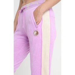 Fenty PUMA by Rihanna FITTED TRACK PANT Spodnie treningowe violet. Spodnie dresowe damskie Fenty PUMA by Rihanna, z bawełny. Za 719.00 zł.