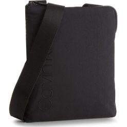 Saszetka CALVIN KLEIN - Straped Flat Crosso K50K503780  001. Czarne saszetki męskie Calvin Klein, z materiału, młodzieżowe. W wyprzedaży za 239.00 zł.