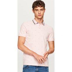 Koszulka polo w drobny wzór - Różowy. Koszulki polo męskie marki Giacomo Conti. W wyprzedaży za 49.99 zł.