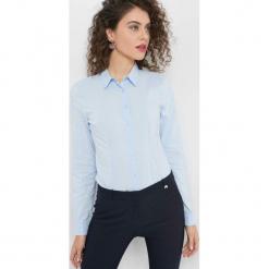 Taliowana koszula. Niebieskie koszule damskie Orsay, z bawełny, eleganckie. Za 59.99 zł.