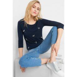 Koszulka z aplikacją 3D. Niebieskie bluzki damskie Orsay, z aplikacjami, z bawełny. Za 39.99 zł.