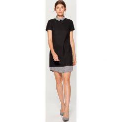 Sukienka z elementami koszulowymi - Czarny. Czarne sukienki damskie Mohito, z koszulowym kołnierzykiem. W wyprzedaży za 99.99 zł.