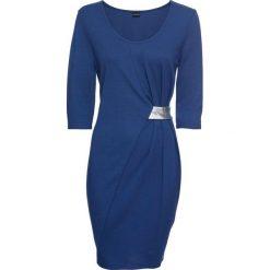 Sukienka z dżerseju z aplikacją bonprix kobaltowo-srebrny. Niebieskie sukienki damskie bonprix, z aplikacjami, z dżerseju, z kopertowym dekoltem. Za 89.99 zł.