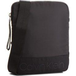 Saszetka CALVIN KLEIN - Shadow Flat Crossove K50K503907 001. Czarne saszetki męskie Calvin Klein, z materiału, młodzieżowe. Za 299.00 zł.