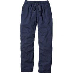 Spodnie sportowe bonprix granatowy. Niebieskie spodnie sportowe męskie bonprix, w paski, z dresówki. Za 54.99 zł.