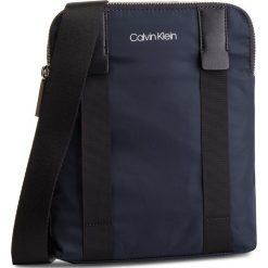 Saszetka CALVIN KLEIN - Braced Flat Crossover K50K504281 068. Niebieskie saszetki męskie Calvin Klein, z materiału, młodzieżowe. Za 349.00 zł.