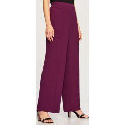 Szerokie spodnie - Fioletowy. Spodnie materiałowe damskie marki DOMYOS. W wyprzedaży za 99.99 zł.