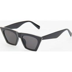 Okulary przeciwsłoneczne - Czarny. Okulary przeciwsłoneczne damskie marki QUECHUA. Za 39.99 zł.