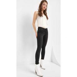 Jegginsy basic. Czarne legginsy damskie Orsay, z bawełny. Za 89.99 zł.