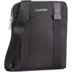 Saszetka CALVIN KLEIN - Braced Flat Crossover K50K504281 001. Czarne saszetki męskie Calvin Klein, z materiału, młodzieżowe. Za 349.00 zł.