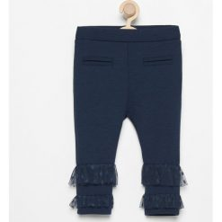 Spodnie z tiulowymi falbanki - Granatowy. Spodenki niemowlęce marki Pollena Savona. W wyprzedaży za 19.99 zł.