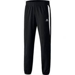 """Spodnie funkcyjne """"Premium One"""" w kolorze czarnym. Spodnie sportowe dla dziewczynek Erima, z nadrukiem, z materiału. W wyprzedaży za 65.95 zł."""