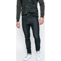 Wrangler - Jeansy Strangler Rinse. Niebieskie jeansy męskie Wrangler. W wyprzedaży za 219.90 zł.