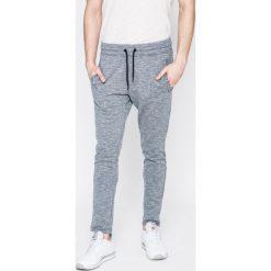 Jack & Jones - Spodnie. Szare spodnie sportowe męskie Jack & Jones, z bawełny. W wyprzedaży za 79.90 zł.
