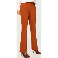 Spodnie na kant - Czerwony. Spodnie materiałowe damskie marki DOMYOS. W wyprzedaży za 99.99 zł.