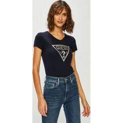 Guess Jeans - Top. Czarne topy damskie Guess Jeans, z aplikacjami, z bawełny, z okrągłym kołnierzem, z krótkim rękawem. Za 139.90 zł.