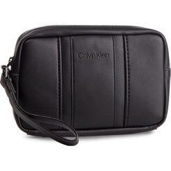 Saszetka CALVIN KLEIN - Essential Compact Case K50K504218 001. Czarne saszetki męskie Calvin Klein, ze skóry ekologicznej, młodzieżowe. Za 299.00 zł.
