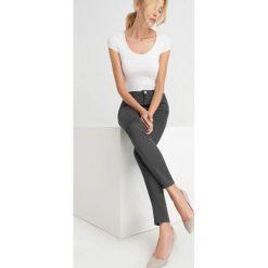 Spodnie skinny. Czarne spodnie materiałowe damskie Orsay, w jednolite wzory, z bawełny. Za 79.99 zł.