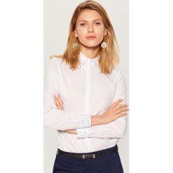Klasyczna koszula z długimi rękawami - Biały. Koszule damskie marki SOLOGNAC. Za 79.99 zł.