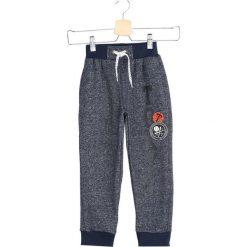 Ciemnoniebieskie Spodnie Dresowe Tokyo Boy. Niebieskie spodnie sportowe dla chłopców Born2be, z dresówki. Za 29.99 zł.