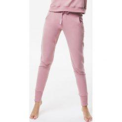 Cardio Bunny - Spodnie Pretty. Szare spodnie sportowe damskie Cardio Bunny, z bawełny. W wyprzedaży za 179.90 zł.