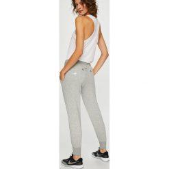 Nike Sportswear - Spodnie. Szare spodnie sportowe damskie Nike Sportswear, z bawełny. Za 259.90 zł.