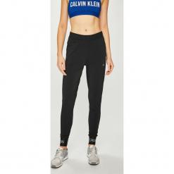 Calvin Klein Performance - Spodnie. Szare spodnie sportowe damskie Calvin Klein Performance, z dzianiny. Za 399.90 zł.