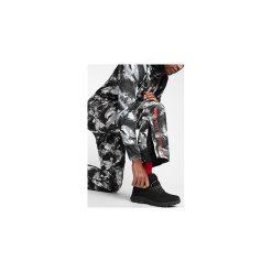Spodnie narciarskie męskie SPMN251A - multikolor allover. Spodnie snowboardowe męskie marki WED'ZE. Za 399.99 zł.