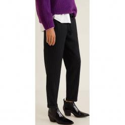 Mango - Spodnie Fluid2. Czarne spodnie materiałowe damskie Mango, z bawełny. Za 119.90 zł.