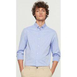 Koszula z żakardowej bawełny regular fit - Niebieski. Niebieskie koszule męskie Reserved, z bawełny. W wyprzedaży za 69.99 zł.