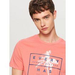 T-shirt z nadrukiem - Pomarańczo. Szare t-shirty i topy dla dziewczynek Reserved, z nadrukiem. W wyprzedaży za 24.99 zł.