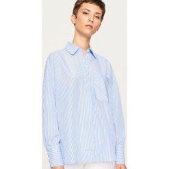 Koszula w paski - Wielobarwn. Koszule damskie marki SOLOGNAC. W wyprzedaży za 39.99 zł.
