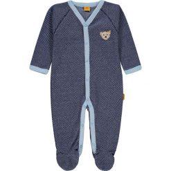 Śpioszki w kolorze granatowym. Niebieskie śpioszki niemowlęce marki Steiff, z bawełny. W wyprzedaży za 85.95 zł.